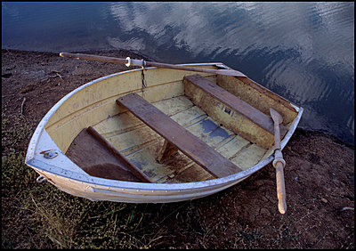 Boat on river embankment - p3720005 by G A Weitz