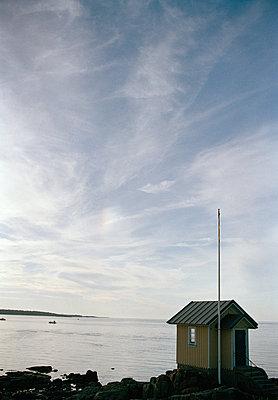 A bathing hut by the ocean Skane Sweden - p5281269f by Dan Lepp