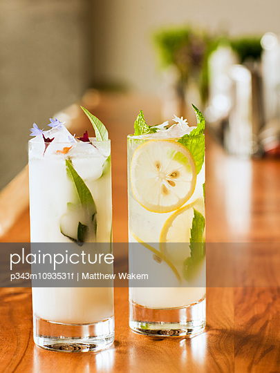 Mocktail drinks at bar. - p343m1093531f by Matthew Wakem photography
