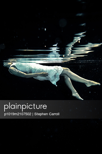 Underwater View of Woman Floating - p1019m2107502 by Stephen Carroll