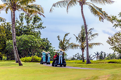 Golf carts on golf course in Bali - p1108m1441022 by trubavin