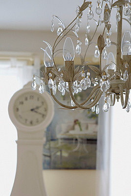 Crystal drop chandelier in room with Gustavian clock - p349m789780 by Brent Darby