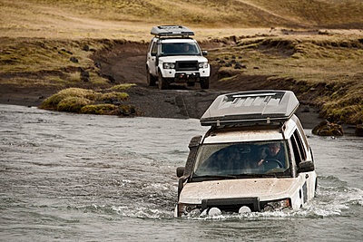 SUV crossing deep river;  Fjallabak;  Iceland - p429m860222f by Henn Photography