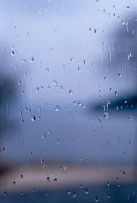 Raindrops on a window  close-up - p5280244f by Camilla Sjodin