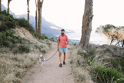 South Africa, Man with dog on a path - p1640m2246177 by Holly & John