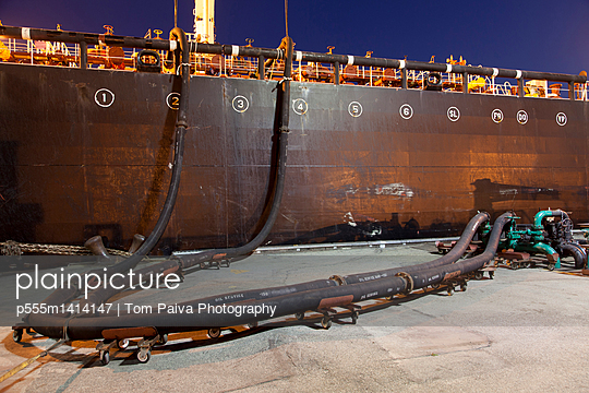 Oil tanker ship docked in industrial harbor - p555m1414147 by Tom Paiva Photography