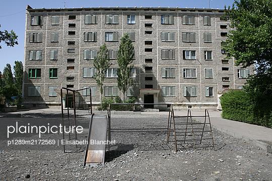 Empty playground in front of block in Tashkent - p1289m2172569 by Elisabeth Blanchet