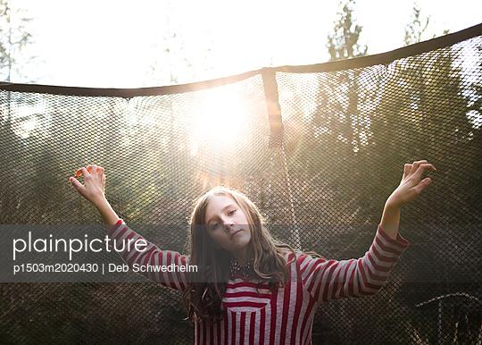 Girl on Trampoline - p1503m2020430 by Deb Schwedhelm