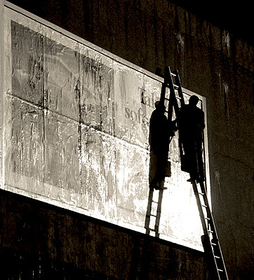 Pasting a poster, King's Cross area of London, 1984 - p1365m1355180 by John Heseltine