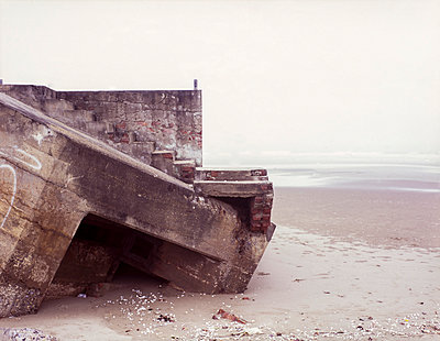 Remains of an old concrete bunker on a beach of Vinh in Nghe An Province - p934m1022280 by Sebastien Loffler