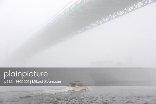 Bridge and boat in fog - p312m993122f by Mikael Svensson