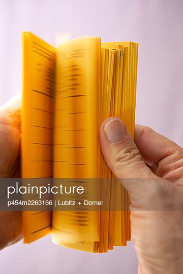 Flipping through vaccination certificates - p454m2263166 by Lubitz + Dorner