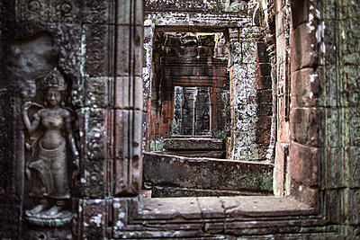 Detail of an entrance at the Ta Prohm temple in Angkor Wat, Siem Reap, Cambodia. - p343m1218093 by Guillem Lopez