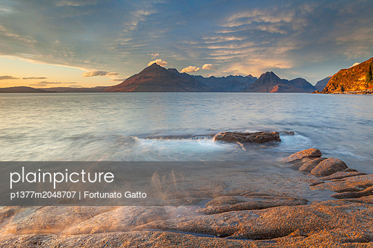 United Kingdom, Scotland, Inner Hebrides, Great Britain, British Isles, Isle of Skye, During the sunset the sidelighting  reaches and hits Elgol Beach - p1377m2048707 by Fortunato Gatto