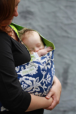 Qoman holding newborn baby in sling - p6070502 by Gina Kelly
