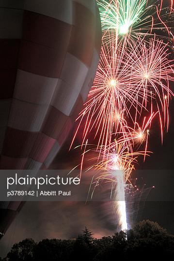Hot air balloon with fireworks - p3789142 by Abbitt Paul