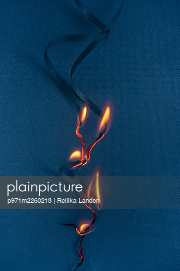Burning paper strips - p971m2260218 by Reilika Landen