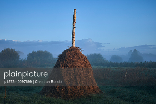 Haystack in the morning light - p1573m2297699 by Christian Bendel