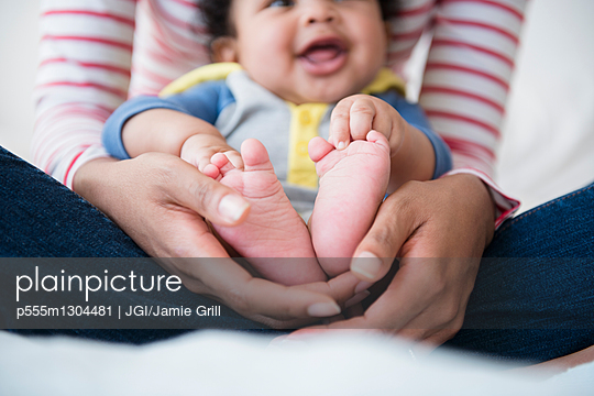 Mother holding baby son in lap - p555m1304481 by JGI/Jamie Grill