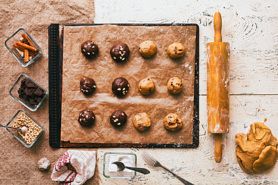 Cookie dough on baking sheet near rolling pin and ingredients - p555m1444073 by Denis Tevekov
