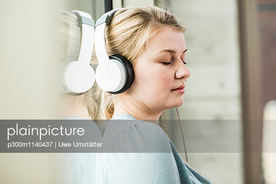 Relaxed young woman listening to music