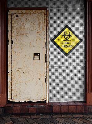 Locked steel door with Biohazard symbol  - p1280m2168642 by Dave Wall