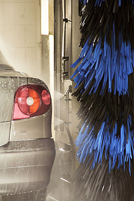 Car going through carwash - p429m875856f by Sigrid Gombert
