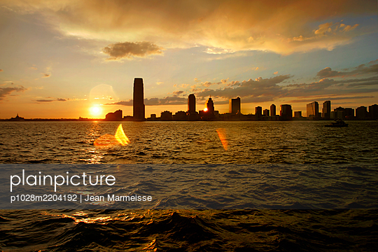 Jersey City from Manhattan at sunset, NYC - p1028m2204192 by Jean Marmeisse