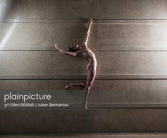 Naked man takes a leap - p1139m1503045 by Julien Benhamou