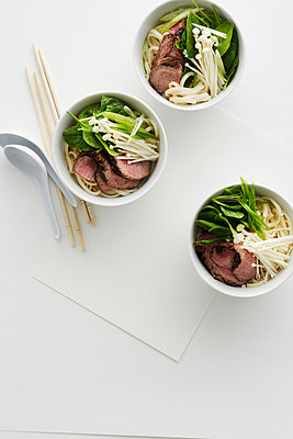 Beef and mushrooms in udon noodles - p42919176 by Brett Stevens