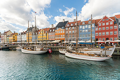 Nyhavn with old ships anchored - p1332m1528894 by Tamboly