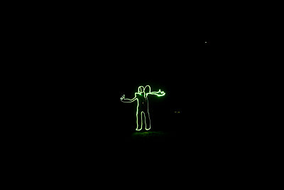 Light painting of a figure with a thumbs up in Idaho - p3436829f by Patrick Orton
