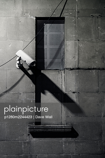 Security camera at night casting long shadow - p1280m2244423 by Dave Wall
