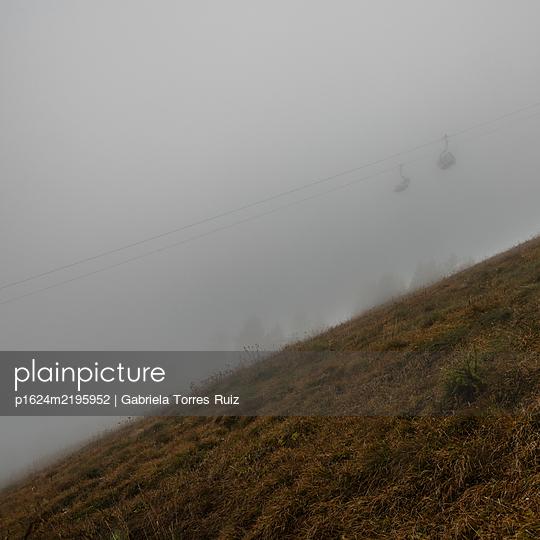 Cable car in dense fog, Dolomites - p1624m2195952 by Gabriela Torres Ruiz