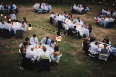 Wedding reception in the garden at night - p1150m1514937 by Elise Ortiou Campion