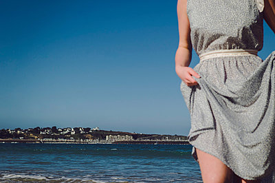 Woman in summer dress on the beach - p1150m2260468 by Elise Ortiou Campion