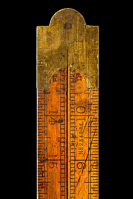 Old vintage wood and brass folding ruler - p1302m2273403 by Richard Nixon
