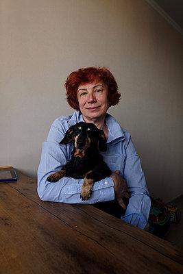 Elderly woman with dog - p1363m2177575 by Valery Skurydin