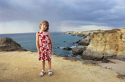 Little girl standing near a gap - p3660003 by Hartmut Gerbsch