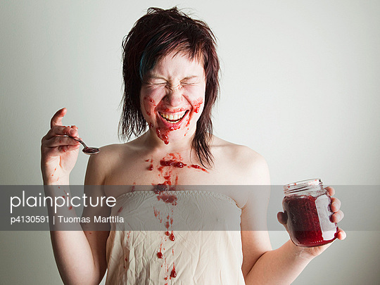 Woman playing with food - p4130591 by Tuomas Marttila
