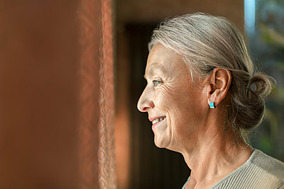 Profile of smiling senior woman - p300m2059641 by Vladimir Godnik