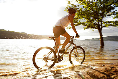 Girl doing offroad bicycle at the end of a spring day - p8490004 by Eric Zeziola