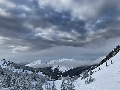 Snow in the mountains - p1048m2016554 by Mark Wagner