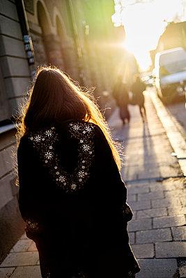 Sweden, Stockholm, Sodermalm, Rear view of walking woman - p352m1079025f by Lena Katarina Johansson