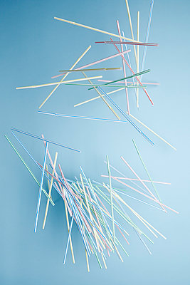 Falling plastic straws  - p1540m2185323 by Marie Tercafs