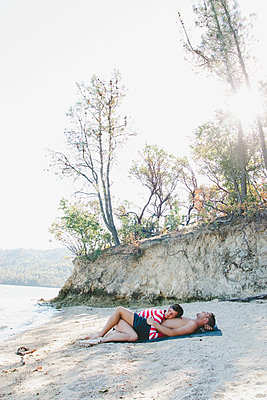 Couple Cuddling on Shore - p1262m1063972 by Maryanne Gobble
