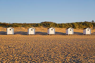 Huts on the beach - p299m2030672 by Silke Heyer