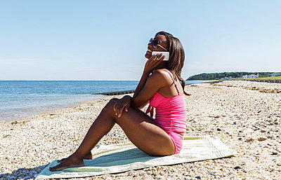 At the beach with the mobile phone - p448m851120 by Safia Fatimi