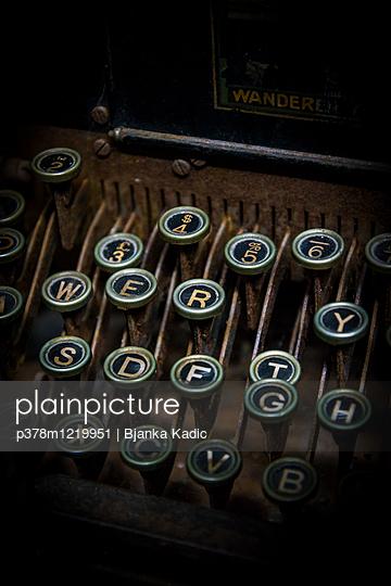 Close-up of old typewriter with damaged keys