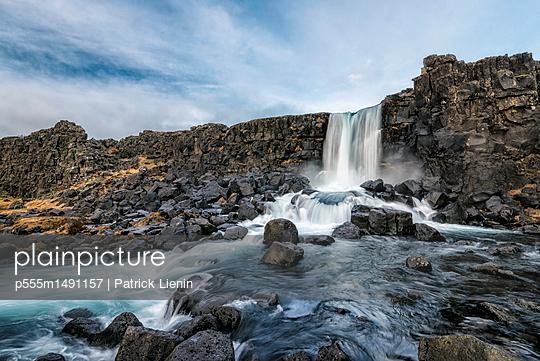 Waterfall on rocks, Pingvellir, Southern Iceland, Iceland - p555m1491157 by Patrick Lienin
